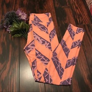 LuLaRoe Peach And Purple Print Leggings Size OS